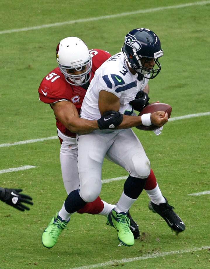 Seattle Seahawks quarterback Russell Wilson (3) is tackled by Arizona Cardinals linebacker Paris Lenon (51) during the first half of an NFL football game, Sunday, Sept. 9, 2012,in Glendale, Ariz. (AP Photo/Rick Scuteri) Photo: Rick Scuteri, Associated Press / FR157181