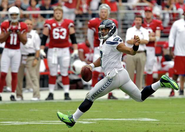 Seattle lost in Russell Wilson's debut, but Jason Garrett is impressed with the rookie QB. Ross D. Franklin/Associated Press Photo: Ross D. Franklin, Associated Press / AP