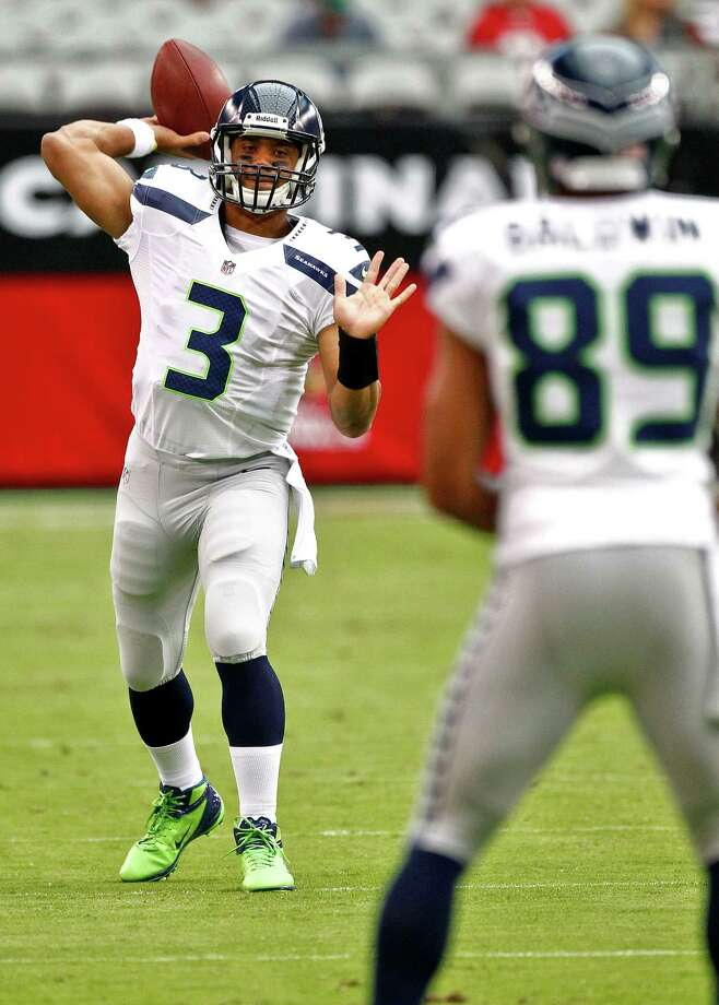 Seattle Seahawks quarterback Russell Wilson (3) warms up with teammate Doug Baldwin (89) prior to an NFL football game against the Arizona Cardinals, Sunday, Sept. 9, 2012, in Glendale, Ariz. (AP Photo/Matt York) Photo: Matt York, Associated Press / AP