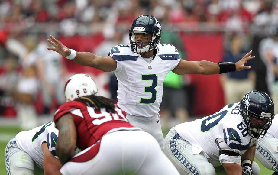 Seattle Seahawks quarterback Russell Wilson (3) calls a play against the Arizona Cardinals during the first half of an NFL football game, Sunday, Sept. 9, 2012,in Glendale, Ariz. (AP Photo/Paul Connors) Photo: Paul Connors, Associated Press / FR5880 AP