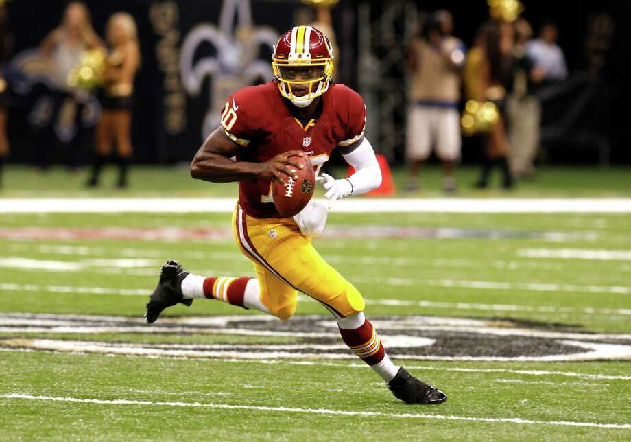 Washington Redskins quarterback Robert Griffin III (10) rushes in the first half of an NFL football game against the New Orleans Saints at the Mercedes-Benz Superdome in New Orleans, Sunday, Sept. 9, 2012.  (AP Photo/Bill Haber) Photo: Bill Haber, Associated Press / FR170136 AP