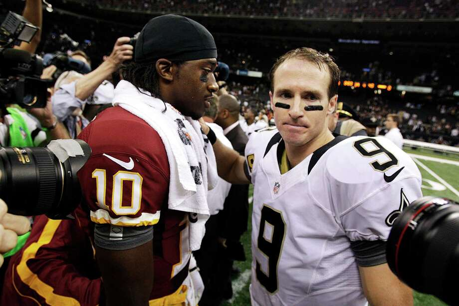 New Orleans Saints quarterback Drew Brees (9) greets Washington Redskins quarterback Robert Griffin III (10) after an NFL football game in New Orleans, Sunday, Sept. 9, 2012. The Redskins won 40-32. (AP Photo/Matthew Hinton) Photo: Matthew Hinton, Associated Press / FR170690 AP