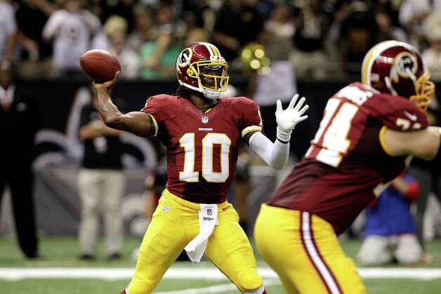 Washington Redskins quarterback Robert Griffin III (10) passes in the second half of an NFL football game against the New Orleans Saints at the Mercedes-Benz Superdome in New Orleans, Sunday, Sept. 9, 2012. (AP Photo/Matthew Hinton) Photo: Matthew Hinton, Associated Press / FR170690 AP