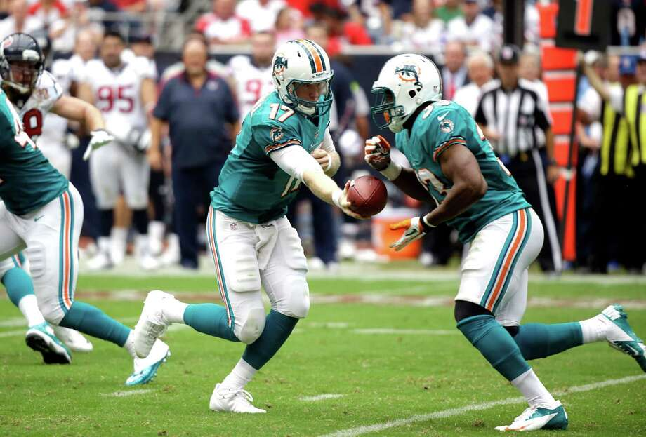 Miami Dolphins quarterback Ryan Tannehill (17) hands the ball off to running back Daniel Thomas (33) in the second quarter of an NFL football game against the Houston Texans  Sunday, Sept. 9, 2012, in Houston. (AP Photo/Eric Gay) Photo: Eric Gay, Associated Press / AP