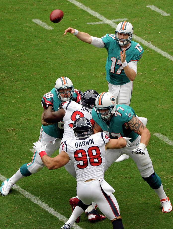 Miami Dolphins quarterback Ryan Tannehill (17) passes against the Houston Texans in the first quarter of an NFL football game on Sunday, Sept. 9, 2012, in Houston. (AP Photo/Dave Einsel) Photo: Dave Einsel, Associated Press / FR43584 AP
