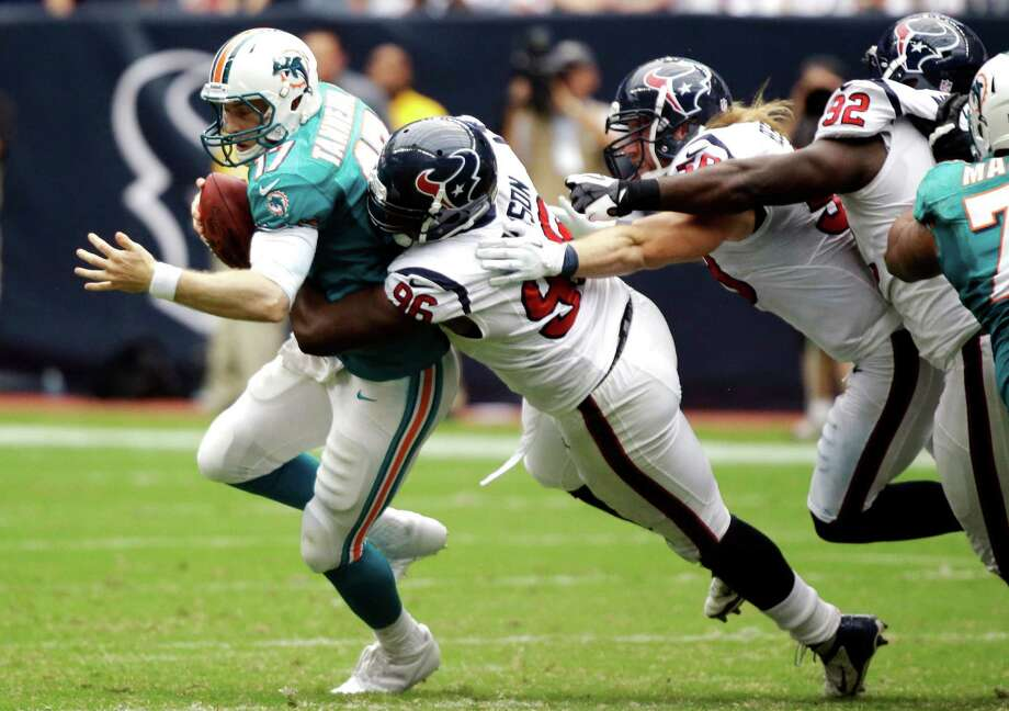 Miami Dolphins quarterback Ryan Tannehill (17) is sacked by Houston Texans defensive end Tim Jamison (96) as Brooks Reed (58) and Earl Mitchell (92) join the tackle during the fourth quarter of an NFL football game, Sunday, Sept. 9, 2012, in Houston. The Texans won 30-10. (AP Photo/Eric Gay) Photo: Eric Gay, Associated Press / AP