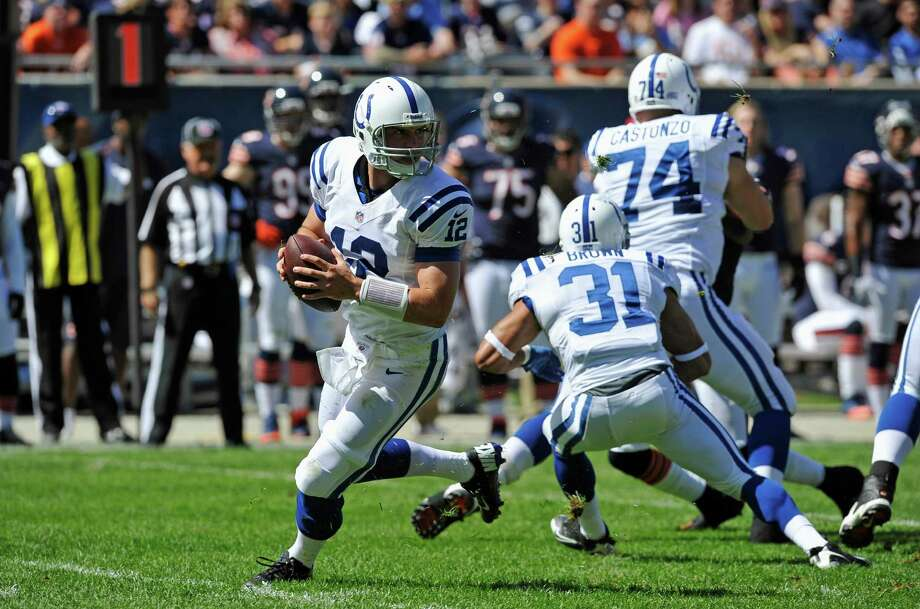 Indianapolis Colts quarterback Andrew Luck (12) rolls out to pass against the Chicago Bears during the first half of an NFL football game in Chicago, Sunday, Sept. 9, 2012. (AP Photo/Jim Prisching) Photo: Jim Prisching, Associated Press / FR59933 AP