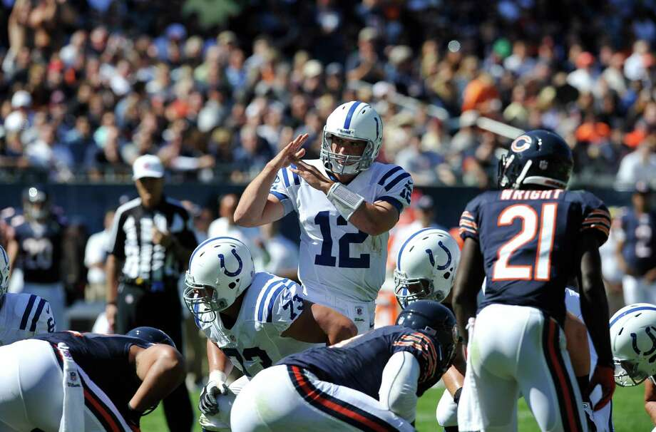 Indianapolis Colts quarterback Andrew Luck (12) calls for time out during the second half of an NFL football game against the Chicago Bears in Chicago, Sunday, Sept. 9, 2012. (AP Photo/Jim Prisching) Photo: Jim Prisching, Associated Press / FR59933 AP