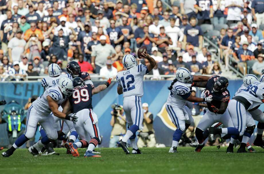 Indianapolis Colts quarterback Andrew Luck (12) passes against the Chicago Bears during the first half of an NFL football game in Chicago, Sunday, Sept. 9, 2012. (AP Photo/Sitthixay Ditthavong) Photo: Sitthixay Ditthavong, Associated Press / AP