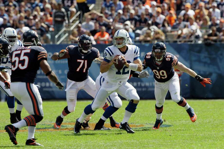 Indianapolis Colts quarterback Andrew Luck (12) looks for a receiver against the Chicago Bears during the first half of an NFL football game in Chicago, Sunday, Sept. 9, 2012. (AP Photo/Nam Y. Huh) Photo: Nam Y. Huh, Associated Press / AP