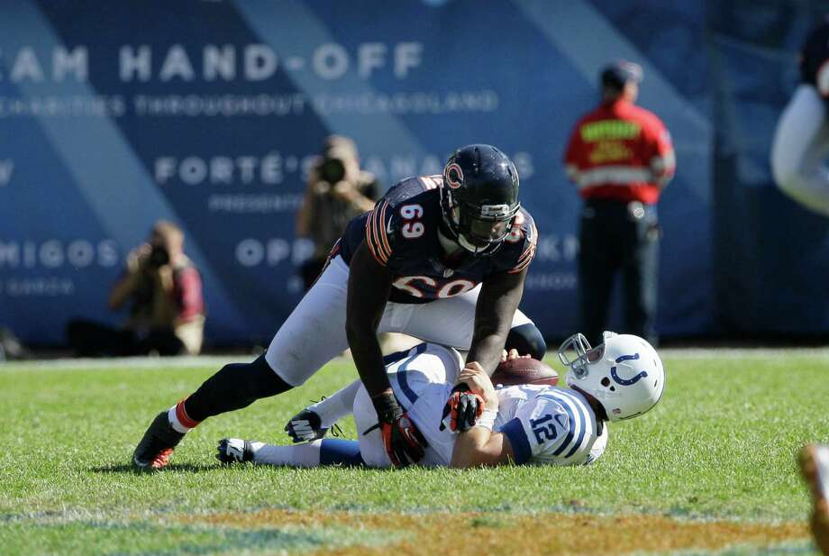Chicago Bears defensive end Henry Melton (69) sacks Indianapolis Colts quarterback Andrew Luck (12) during the second half of an NFL football game in Chicago, Sunday, Sept. 9, 2012. The Bears defeated the Colts 41-21.  (AP Photo/Nam Y. Huh) Photo: Nam Y. Huh, Associated Press / AP