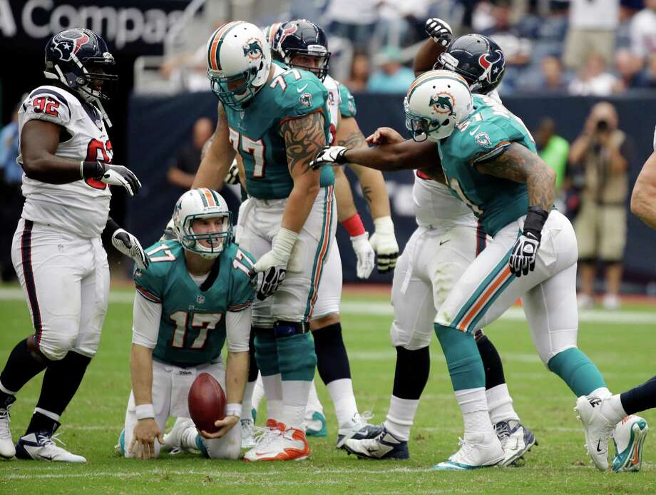 Miami Dolphins' Ryan Tannehill (17) reacts after he was sacked during play against the Houston Texas in the fourth quarter of an NFL football game Sunday, Sept. 9, 2012, in Houston. The Texans won 30-10. (AP Photo/Eric Gay) Photo: Eric Gay, Associated Press / AP