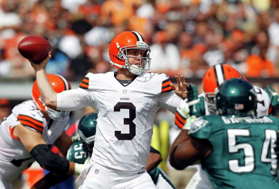 Cleveland Browns quarterback Brandon Weeden passes in the second quarter of an NFL football game against the Philadelphia Eagles Sunday, Sept. 9, 2012, in Cleveland. (AP Photo/Ron Schwane) Photo: Ron Schwane, Associated Press / FR78273 AP