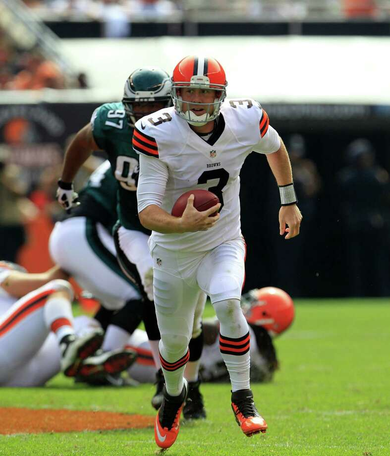 Cleveland Browns quarterback Brandon Weeden (3) runs the ball in the second quarter of an NFL football game against the Philadelphia Eagles Sunday, Sept. 9, 2012, in Cleveland. (AP Photo/Tony Dejak) Photo: Tony Dejak, Associated Press / AP