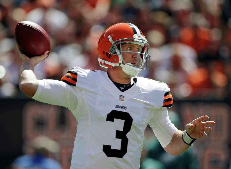 Cleveland Browns quarterback Brandon Weeden passes against the Philadelphia Eagles in the first quarter of an NFL football game on Sunday, Sept. 9, 2012, in Cleveland. (AP Photo/Mark Duncan) Photo: Mark Duncan, Associated Press / AP