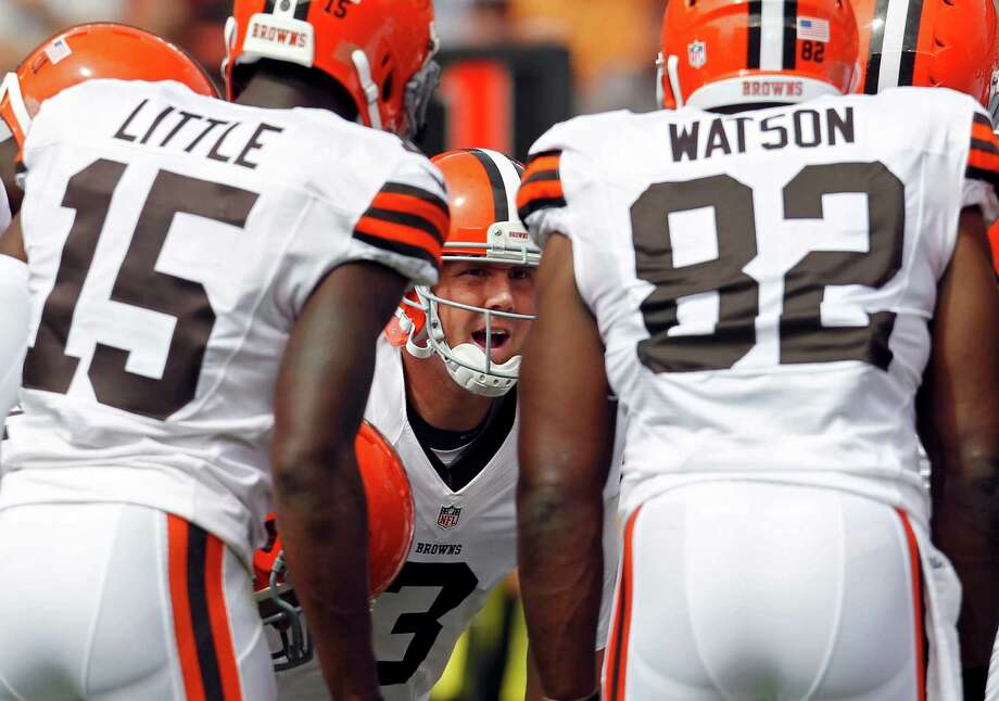Cleveland Browns quarterback Brandon Weeden (3) calls a play in the huddle in the second quarter of an NFL football game against the Philadelphia Eagles Sunday, Sept. 9, 2012, in Cleveland. (AP Photo/Ron Schwane) Photo: Ron Schwane, Associated Press / FR78273 AP