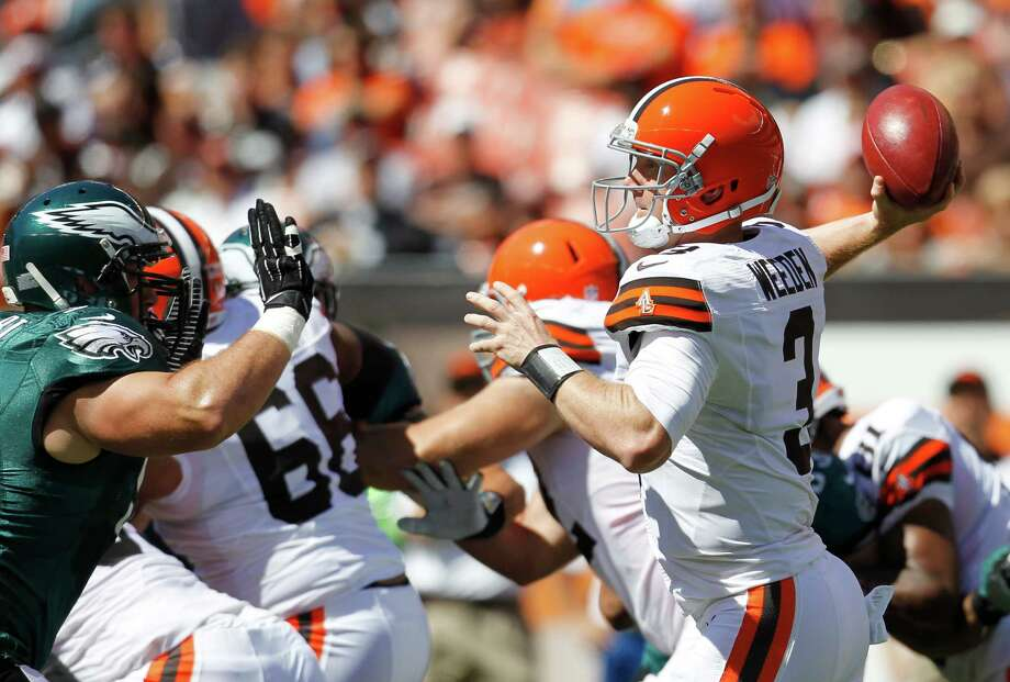 Cleveland Browns quarterback Brandon Weeden (3) throws against the Philadelphia Eagles in the first quarter of an NFL football game Sunday, Sept. 9, 2012, in Cleveland. (AP Photo/Ron Schwane) Photo: Ron Schwane, Associated Press / FR78273 AP