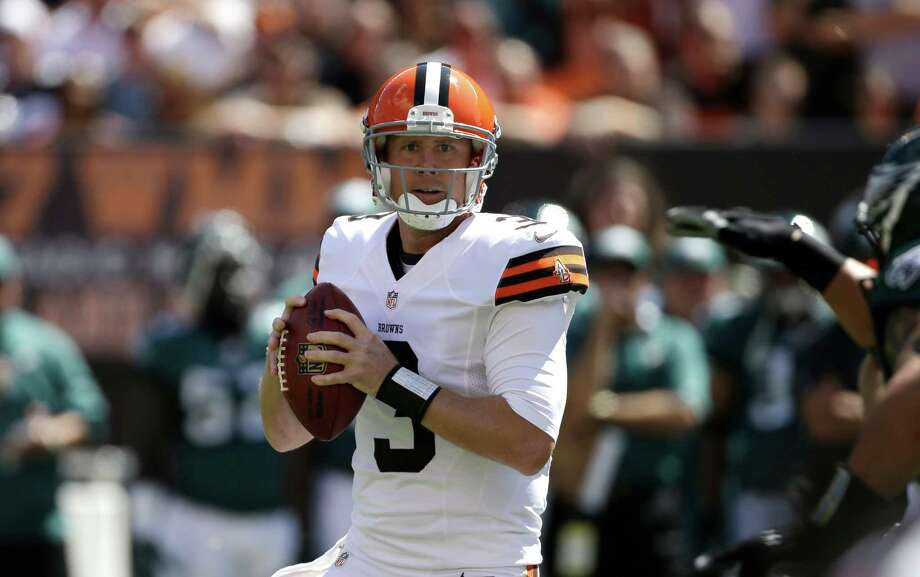 Cleveland Browns quarterback Brandon Weeden (3) looks for a receiver during the first quarter of an NFL football game against the Philadelphia Eagles, Sunday, Sept. 9, 2012, in Cleveland. (AP Photo/Mark Duncan) Photo: Mark Duncan, Associated Press / AP
