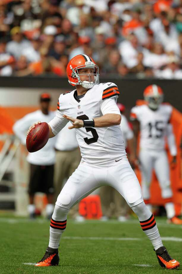 Cleveland Browns quarterback Brandon Weeden drops to pass against the Philadelphia Eagles in the second quarter of an NFL football game Sunday, Sept. 9, 2012, in Cleveland. (AP Photo/Ron Schwane) Photo: Ron Schwane, Associated Press / FR78273 AP