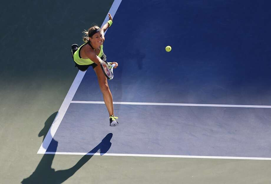 Victoria Azarenka, of Belarus, returns a shot to Serena Williams during the championship match at the 2012 US Open tennis tournament, Sunday, Sept. 9, 2012, in New York. (AP Photo/Julio Cortez) Photo: Julio Cortez, Associated Press
