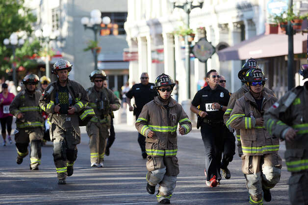 Local and area firefighters and law enforcement personnel compete in the Stephen Siller Tunnel to Towers Run San Antonio 5K at Alamo Plaza, Sunday, Sept. 9, 2012. The top runner in each division will compete in the Tunnel to Towers run in New York City. Siller was a firefighter with the Brooklyn's Squad 1 and died during the attack on the Twin Towers. Photo: Jerry Lara, San Antonio Express-News / © 2012 San Antonio Express-News