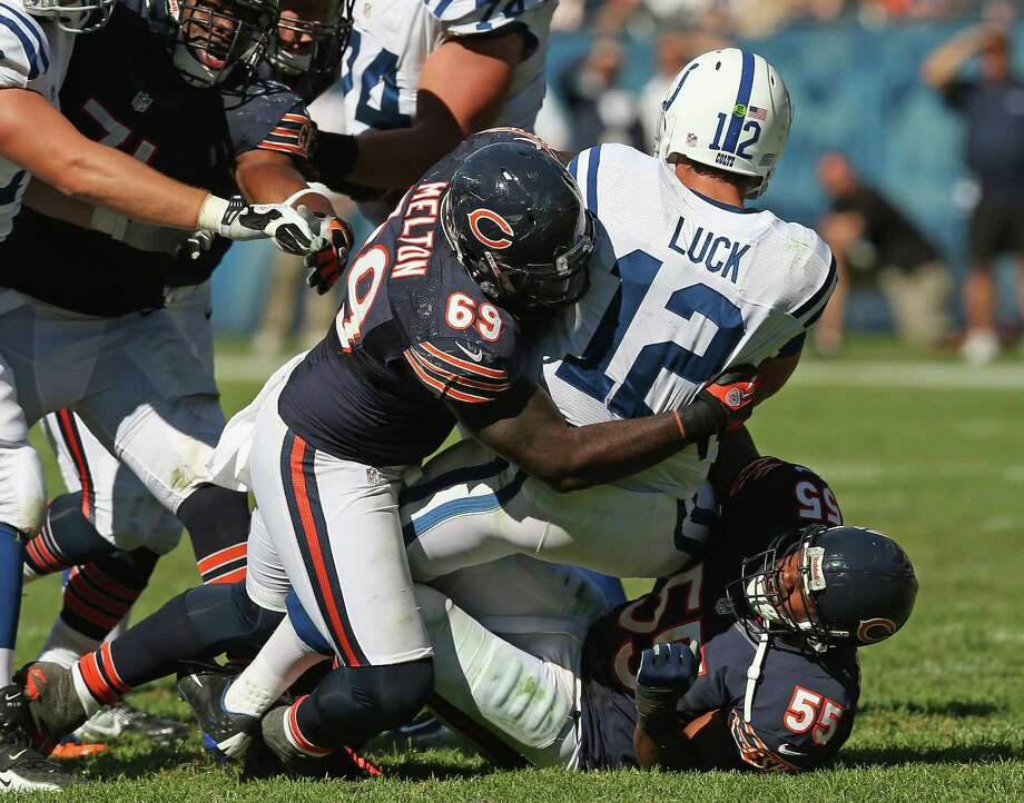 Henry Melton #69 and Lance Briggs #55 of the Chicago Bears sack Andrew Luck #12 of the Indianapolis Colts during their 2012 NFL season opener at Soldier Field on September 9, 2012 in Chicago, Illinois. The Bears defeated the Colts 41-21. Photo: Jonathan Daniel, Getty Images / 2012 Getty Images