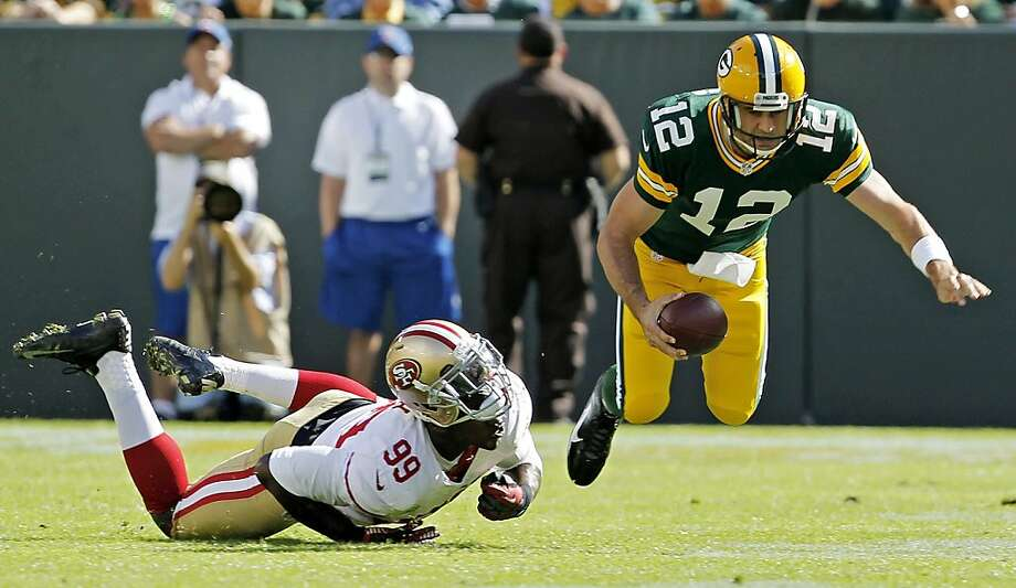 San Francisco 49ers' Aldon Smith (99) sacks Green Bay Packers' Aaron Rodgers (12) during the first half of an NFL football game Sunday, Sept. 9, 2012, in Green Bay, Wis. (AP Photo/Mike Roemer) Photo: Mike Roemer, Associated Press