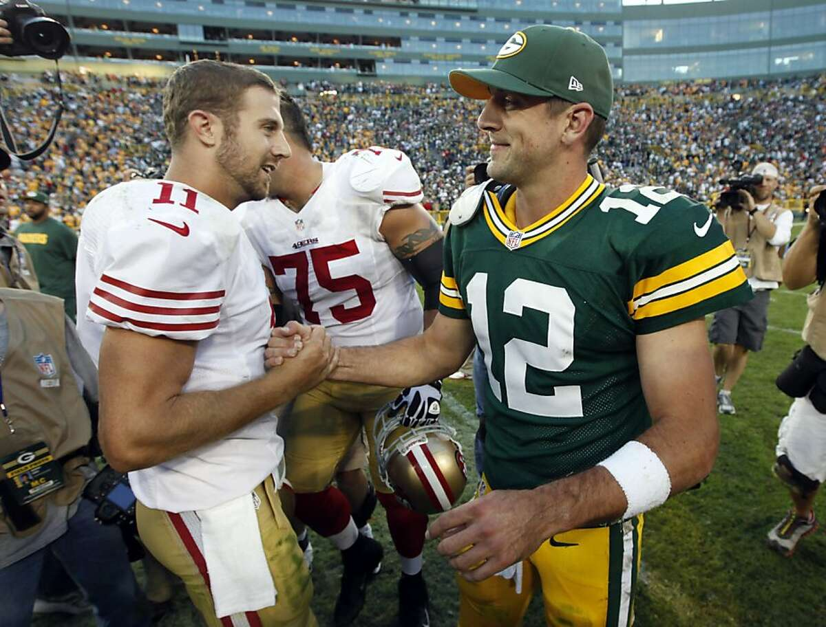San Francisco 49ers' Alex Smith (11) shakes hands with Green Bay Packers' Aaron Rodgers (12) after an NFL football game Monday, Sept. 10, 2012, in Green Bay, Wis. The 49ers won 30-22. (AP Photo/Mike Roemer)
