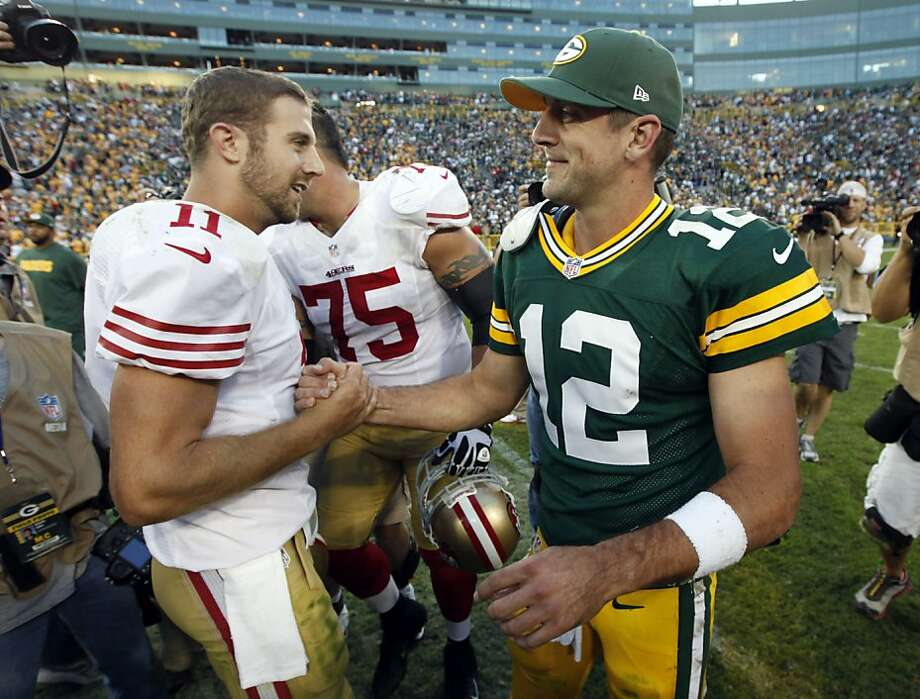 San Francisco 49ers' Alex Smith (11) shakes hands with Green Bay Packers' Aaron Rodgers (12) after an NFL football game Monday, Sept. 10, 2012, in Green Bay, Wis. The 49ers won 30-22. (AP Photo/Mike Roemer) Photo: Mike Roemer, Associated Press