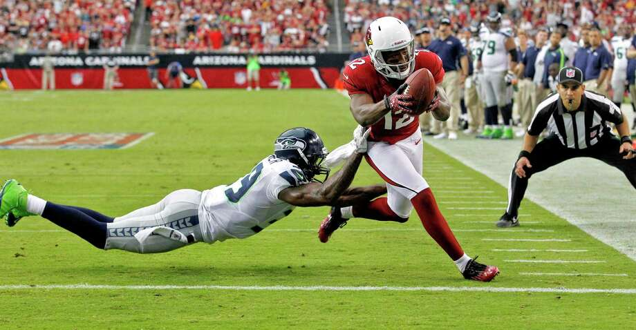 Arizona Cardinals wide receiver Andre Roberts (12) scores a touchdown as Seattle Seahawks cornerback Brandon Browner defends during the second half of an NFL football game, Sunday, Sept. 9, 2012, in Glendale, Ariz. Photo: AP