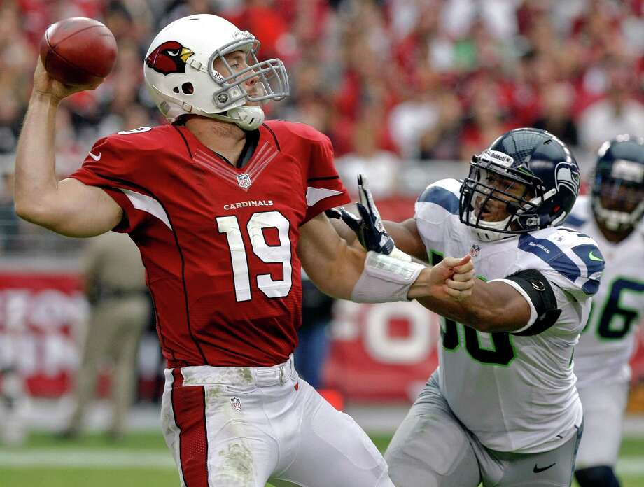 Arizona Cardinals quarterback John Skelton (19) is pressured by Seattle Seahawks linebacker K.J. Wright during the second half of an NFL football game, Sunday, Sept. 9, 2012, in Glendale, Ariz. Skelton left the game with an injured knee. Photo: AP