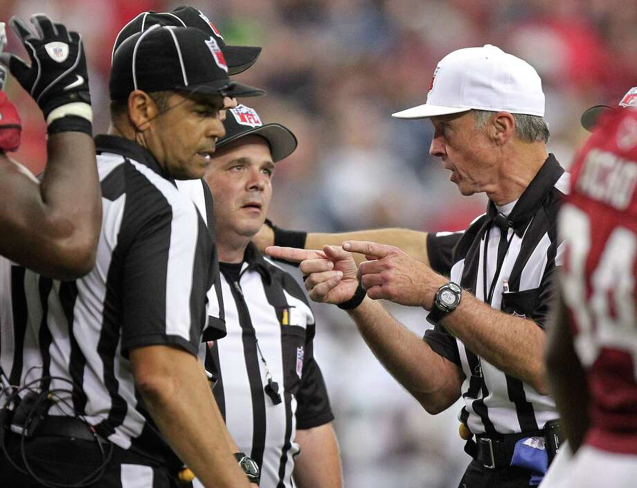 The officials talk during the second half of an NFL football game gbetween the Arizona Cardinals and the Seattle Seahawks, Sunday, Sept. 9, 2012,in Glendale, Ariz. The Cardinals won 20-16. Photo: AP