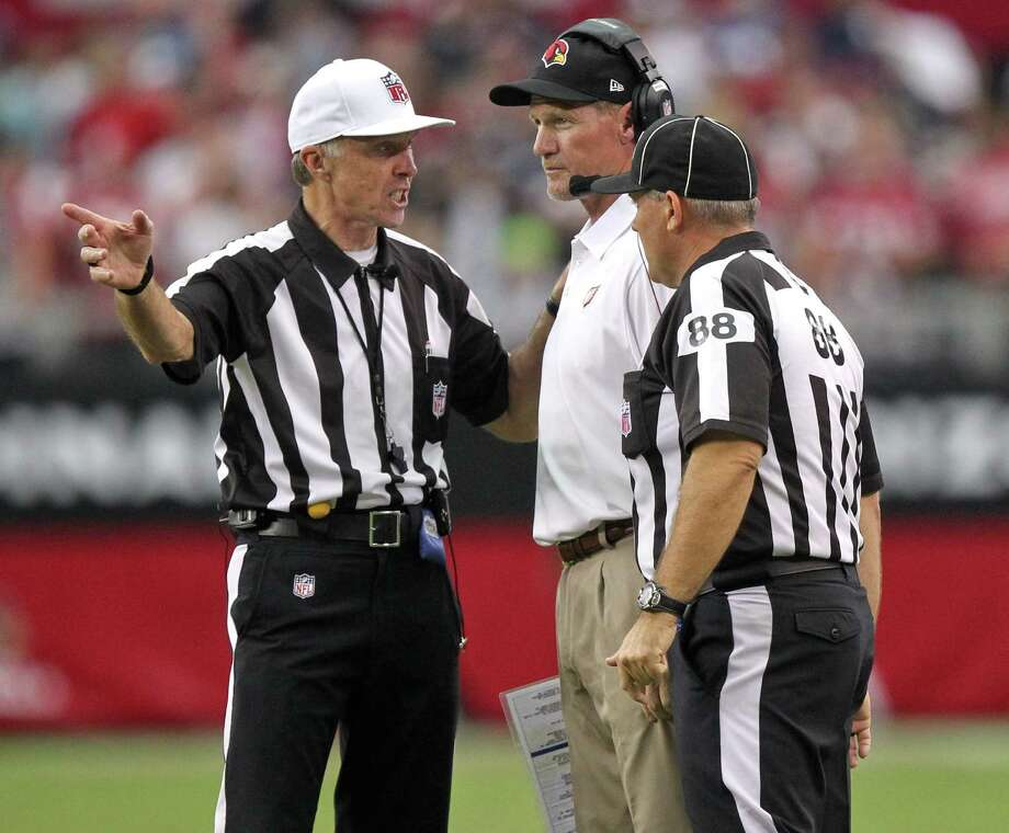 Arizona Cardinals head coach Ken Whisenhunt, center, talks with the officials during the second half of an NFL football game against the Seattle Seahawks , Sunday, Sept. 9, 2012,in Glendale, Ariz. The Cardinals won 20-16. Photo: AP