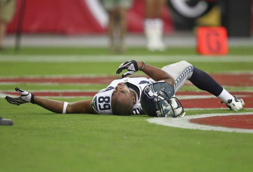 Seattle Seahawks wide receiver Doug Baldwin (89) lies in the end zone after being injured against th