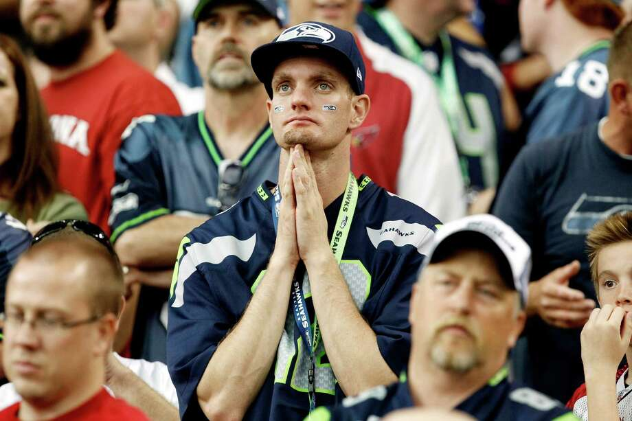 A Seattle Seahawks fan watches the closing moments of their loss to the Arizona Cardinals during the second half of an NFL football game, Sunday, Sept. 9, 2012, in Glendale, Ariz. The Cardinals defeated the Seahawks 20-16. Photo: AP