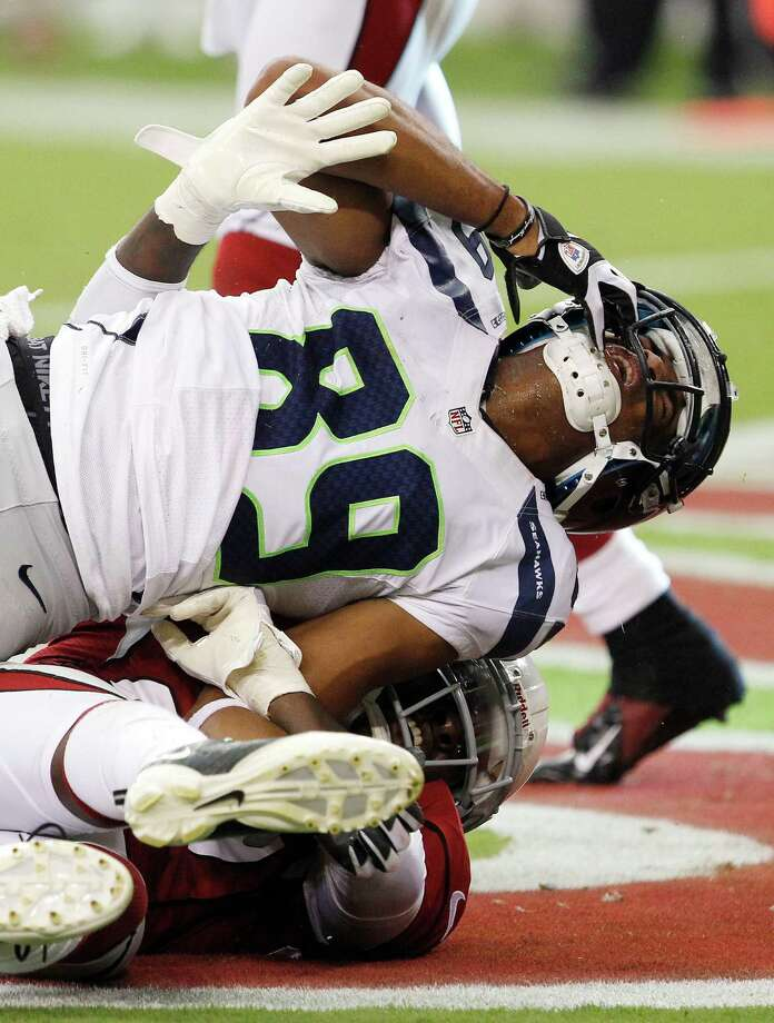 Seattle Seahawks' Doug Baldwin (89) grimaces after smashing his chin on the field as he is tackled by Arizona Cardinals' Michael Adams during the second half in an NFL football game Sunday, Sept. 9, 2012, in Glendale, Ariz.  The Cardinals defeated the Seahawks 20-16. Photo: AP