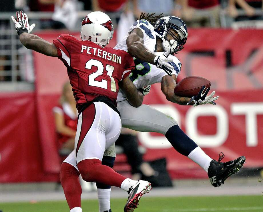 Arizona Cardinals cornerback Patrick Peterson (21) interferes with a pass intended for Seattle Seahawks wide receiver Sidney Rice (18) during the second half of an NFL football game, Sunday, Sept. 9, 2012, in Glendale, Ariz. The Cardinals won 20-16. Photo: AP