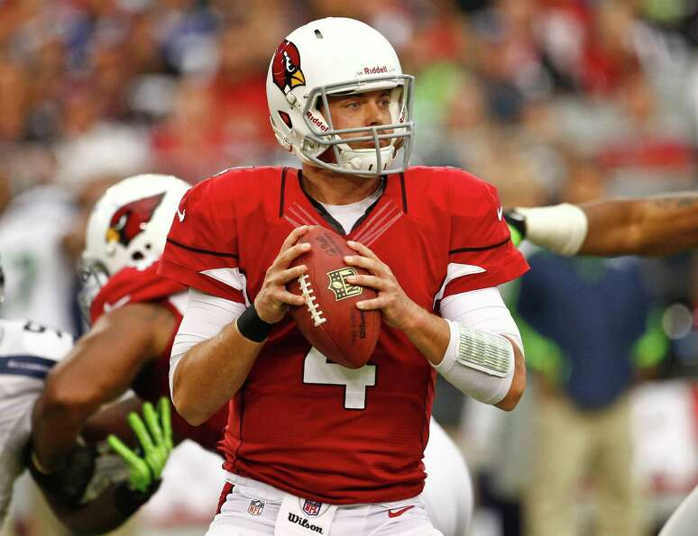 Arizona Cardinals quarterback Kevin Kolb (4) throws during the second half of an NFL football game a