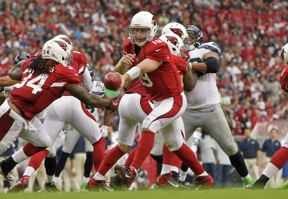 Arizona Cardinals quarterback John Skelton (19) hands off against the Seattle Seahawks during the second half of an NFL football game, Sunday, Sept. 9, 2012,in Glendale, Ariz. Photo: AP