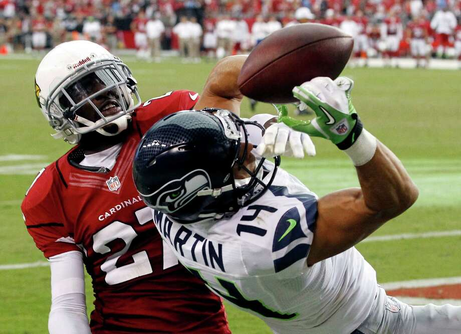 Arizona Cardinals' Michael Adams (27) tips the ball away from Seattle Seahawks' Charly Martin (14) in the end zone during the second half of an NFL football game, Sunday, Sept. 9, 2012, in Glendale, Ariz.  The Cardinals defeated the Seahawks 20-16. Photo: AP