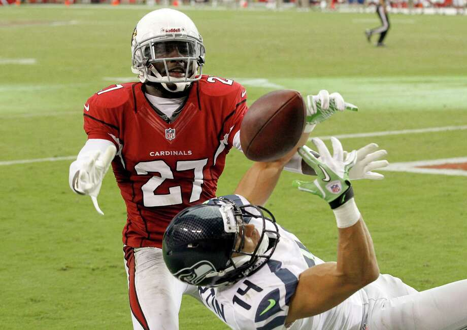 Arizona Cardinals' Michael Adams (27) tips the ball away from Seattle Seahawks' Charly Martin (14) in the end zone during the second half in an NFL football game Sunday, Sept. 9, 2012, in Glendale, Ariz.  The Cardinals defeated the Seahawks 20-16. Photo: AP