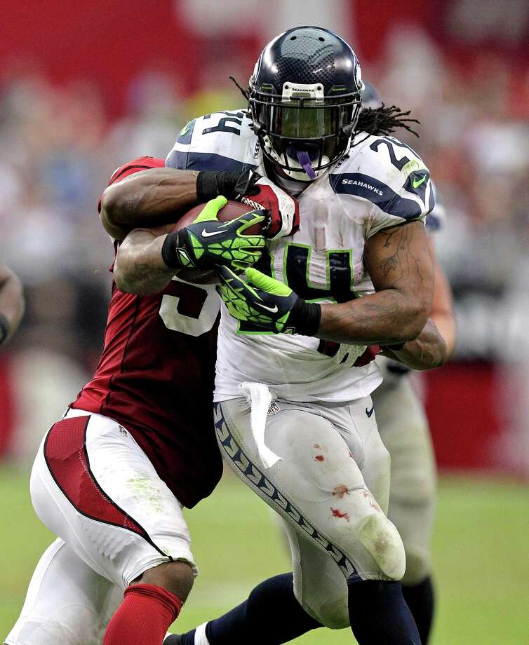 Seattle Seahawks running back Marshawn Lynch (24) is tackled by Arizona Cardinals linebacker Daryl Washington during the second half of an NFL football game, Sunday, Sept. 9, 2012, in Glendale, Ariz. Photo: AP
