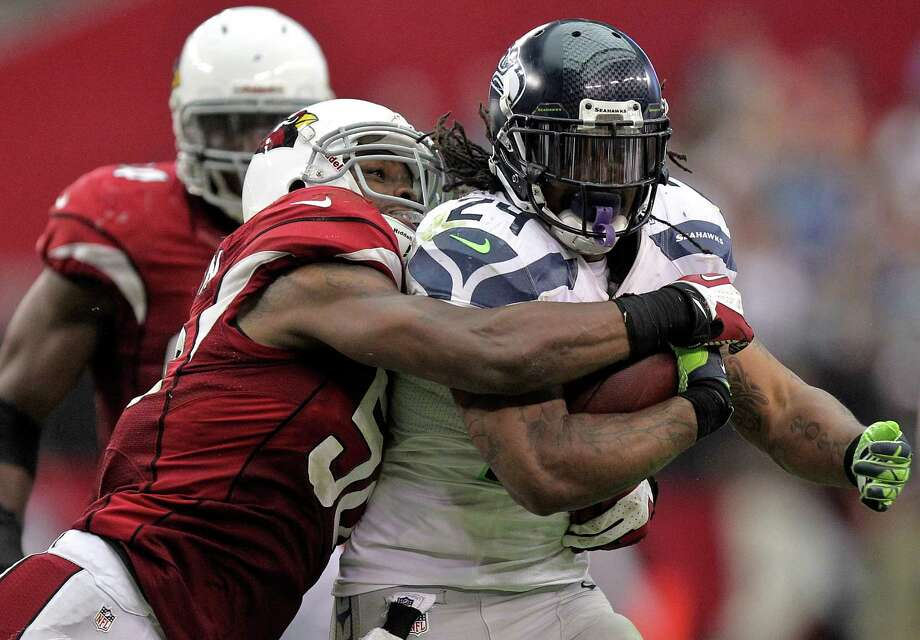 Seattle Seahawks running back Marshawn Lynch (24) is tackled by Arizona Cardinals linebacker Daryl Washington during the second half of an NFL football game, Sunday, Sept. 9, 2012,in Glendale, Ariz. Photo: AP