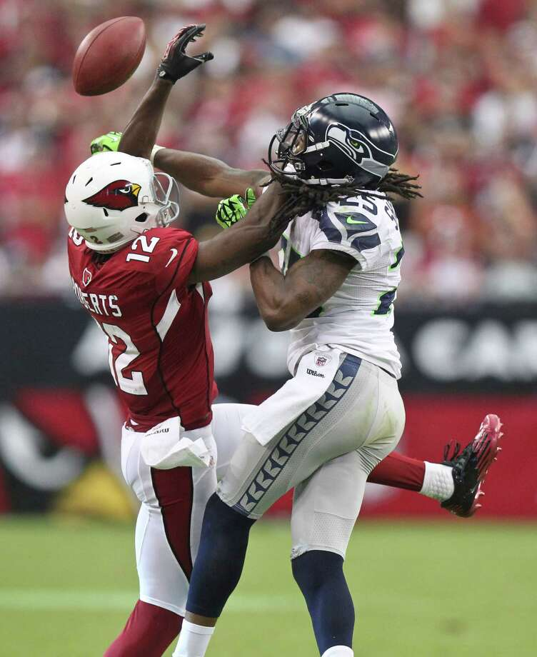 Seattle Seahawks cornerback Richard Sherman, right, breaks up a pass intended for Arizona Cardinals wide receiver Andre Roberts (12) during the second half of an NFL football game, Sunday, Sept. 9, 2012,in Glendale, Ariz. Photo: AP
