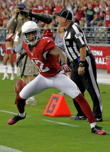 Arizona Cardinals wide receiver Andre Roberts (12) celebrates his touchdown against the Seattle Seah