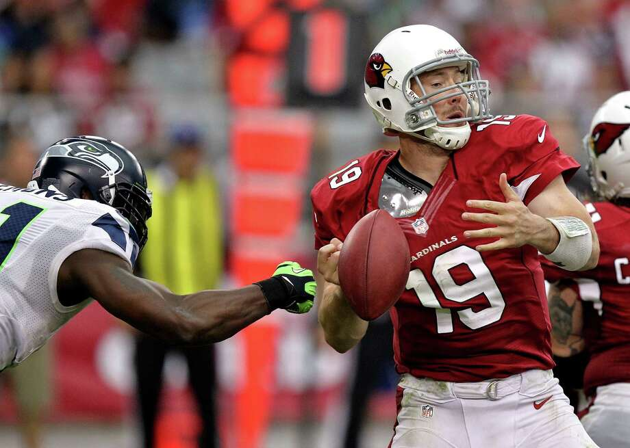 Arizona Cardinals quarterback John Skelton (19) has the ball stripped away by Seattle Seahawks defensive end Chris Clemons (91) during the second half of an NFL football game, Sunday, Sept. 9, 2012,in Glendale, Ariz. Photo: AP