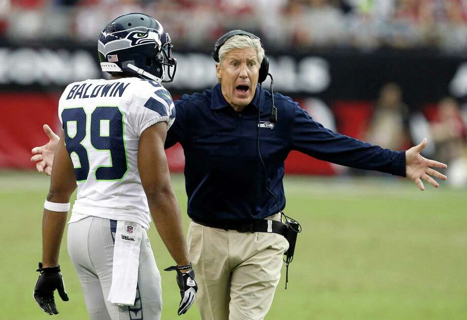 Seattle Seahawks head coach Pete Carroll yells at officials as he tries to call a timeout as Seahawks' Doug Baldwin (89) walks onto the field during the second half of an NFL football game against the Arizona Cardinals, Sunday, Sept. 9, 2012, in Glendale, Ariz.  The Cardinals defeated the Seahawks 20-16. Photo: AP