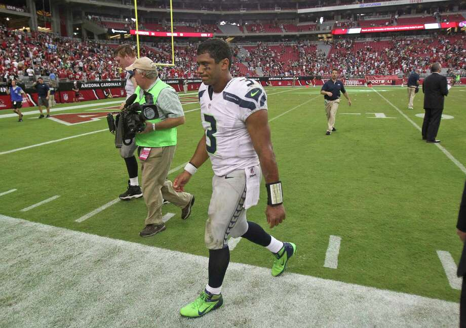 Seattle Seahawks quarterback Russell Wilson (3) leaves the field after losing an NFL football game against the Arizona Cardinals, Sunday, Sept. 9, 2012,in Glendale, Ariz. The Cardinals won 20-16. Photo: AP
