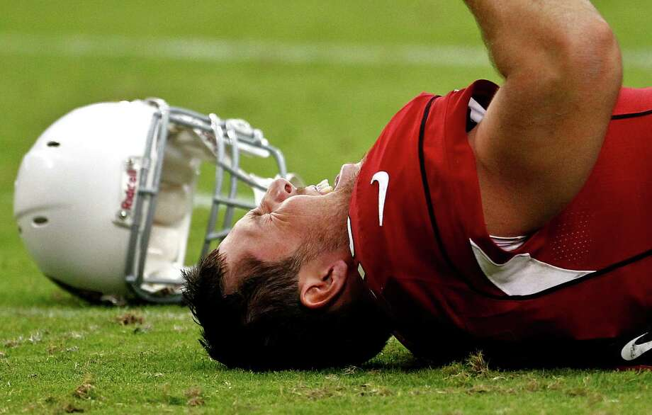 Arizona Cardinals quarterback John Skelton grimaces after being injured against the Seattle Seahawks during the second half of an NFL football game, Sunday, Sept. 9, 2012, in Glendale, Ariz. Skelton left the game. Photo: AP