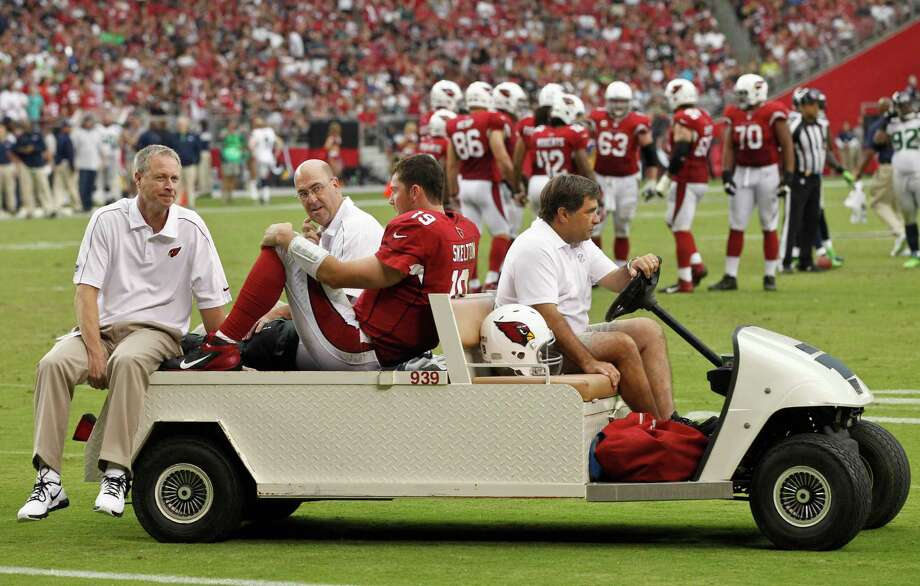 Arizona Cardinals quarterback John Skelton (19) is carted from the field after being injured during the second half of an NFL football game against the Seattle Seahawks, Sunday, Sept. 9, 2012, in Glendale, Ariz. Photo: AP